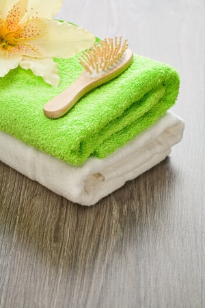 flower on towels with hairbrush photo