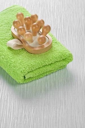 massager: massager on green towel Stock Photo