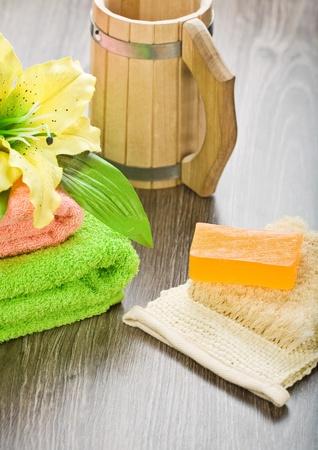 bathe mug: bath accessories on wooden background