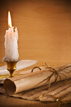 roll of old paper andle candle