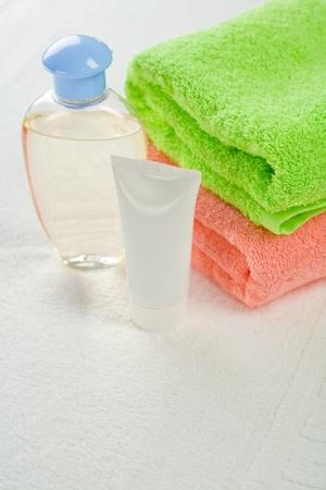 Set for bathing on white towel photo