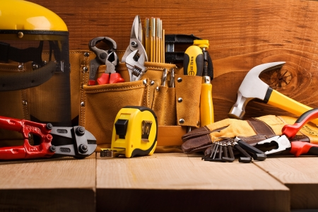 home improvement store: set of working tools on wooden boards