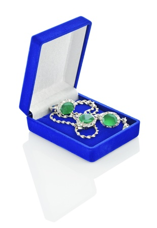 Silver jewelry in dark-blue box isolated photo