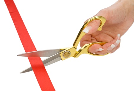 single female hand with Scissors and red tape photo
