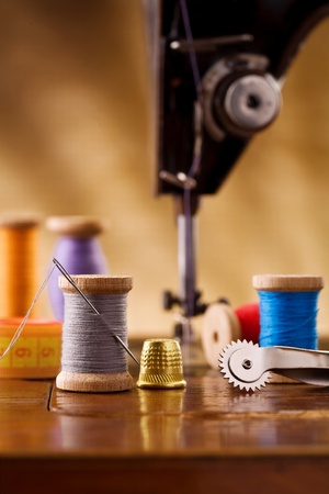 stitching machine: small sewing wooden bobbin with other items