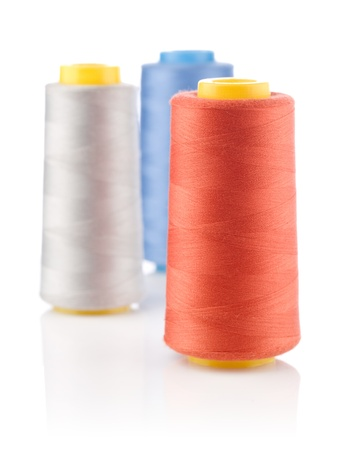 three spools of thread photo