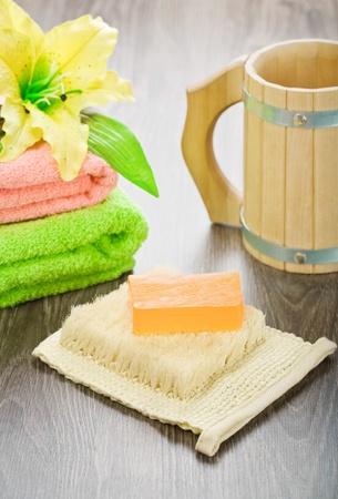 bathe mug: towels flower bast soap and mug Stock Photo