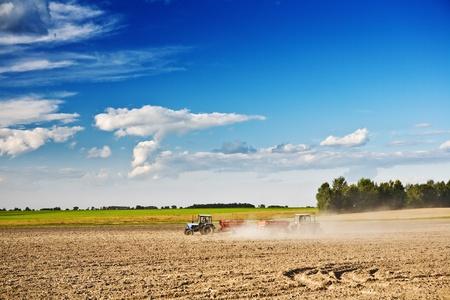 two tractor on the field Foto de archivo