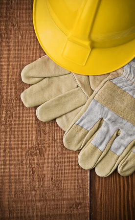 view on a hardhat with gloves on wooden board photo