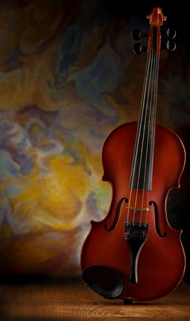 old violin on wooden board Stock Photo