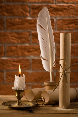 candle with antique writing accessries photo