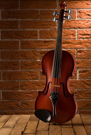 stringed instrument: old violin on table Stock Photo