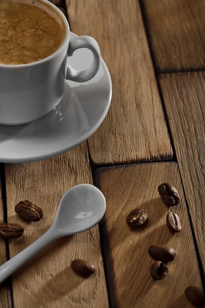 coffee cup and spoon on wooden table photo