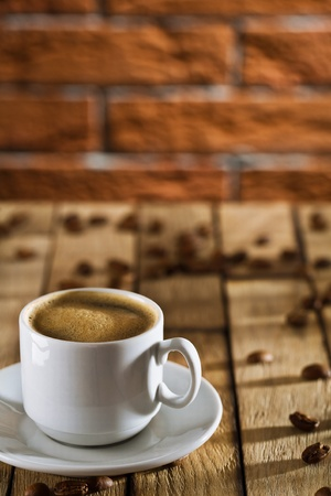 cup with espresso on the wooden boards photo