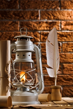 composition of old writing items and kerosene lamp photo