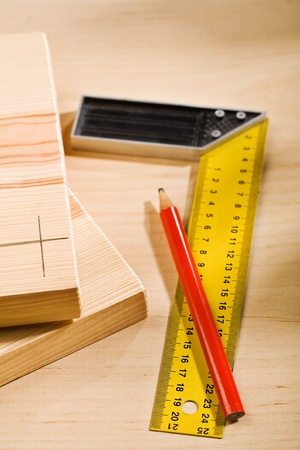 set-square ruler and pencil with boards Stock Photo - 13515312