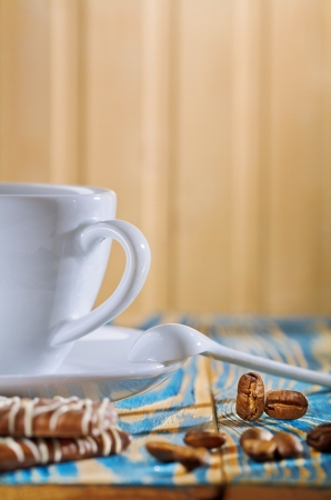 cup and cookies with coffee beans photo