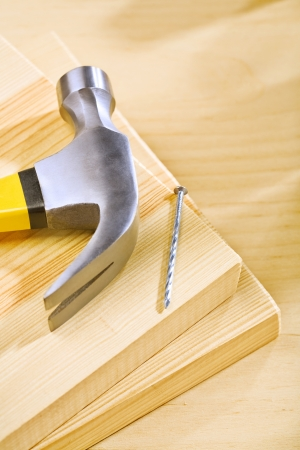 hammer and nail on wooden boards photo