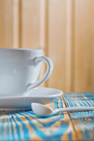 white coffee cup on the old wooden table photo