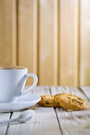coffee cup and cookies on old white table photo