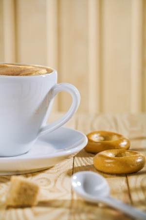 composition of the white coffee cup with spoon and bread tor, bar of sugar Stock Photo - 13914294