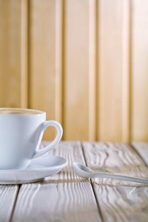 white coffee cup and spoon on old table Stock Photo - 13914293