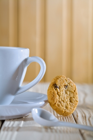 closeup composition. blue coffee cup with spoon and cookie photo
