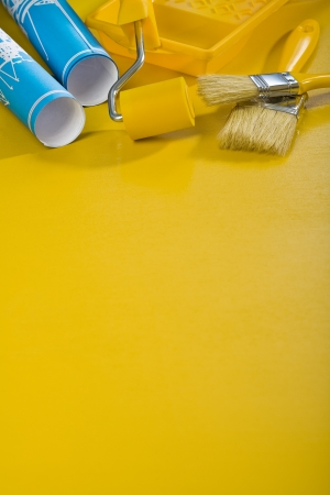 paint tools on yellow background with copyspace photo