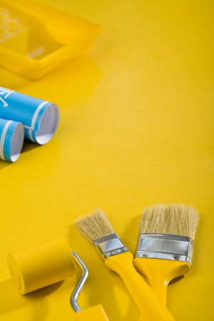 paint tools on yellow table photo
