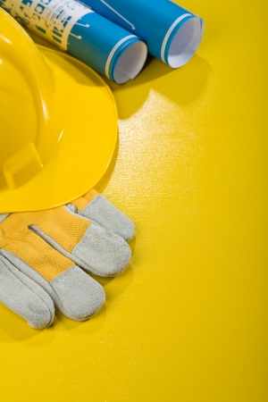 vertical copyspace image of working tools on yellow table photo