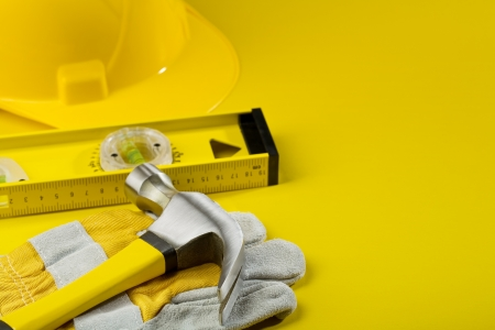 working tools on yellow background photo
