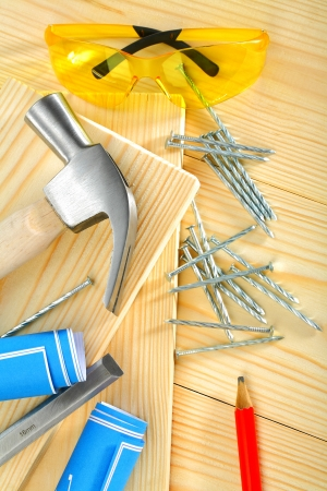composition of carpentry tools on  wooden background photo