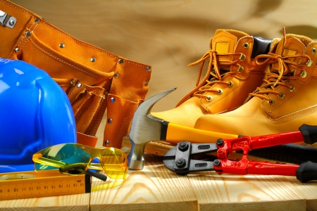 work belt: composition of working tools on  wooden boards Stock Photo