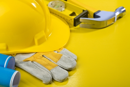 composition of working tools on yellow table photo