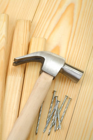hammer on planks and nails photo