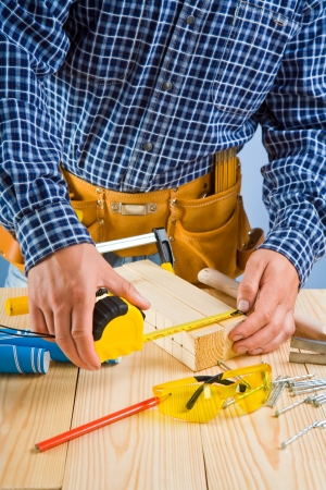carpenter works with roulette Stock Photo - 14470674