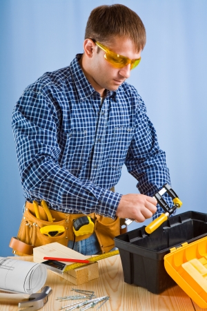 carpenter vise: worker takes carpenter vise Stock Photo