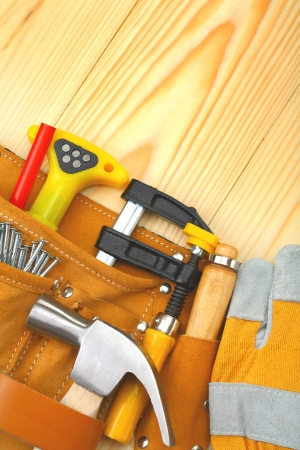 craft work: tools in belt on wooden boards Stock Photo