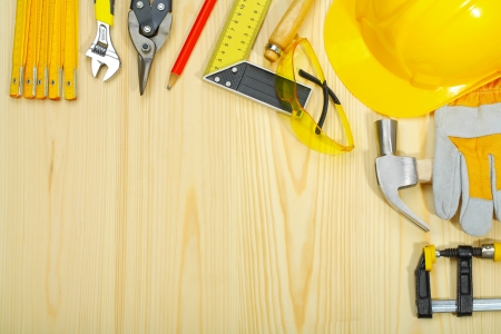 copyspace of construction tools on wooden boards photo