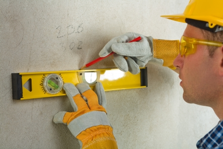 worker with construction level