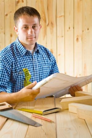 carpenter with blueprint Stock Photo - 16335401