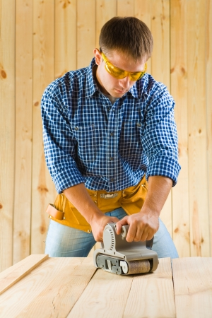 men works with detail sander Stock Photo - 16335400