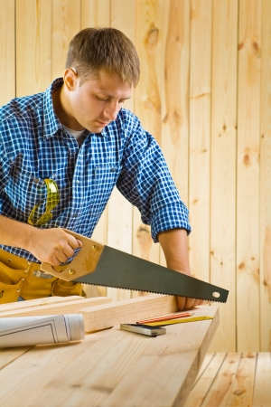 worker works with handsaw Stock Photo - 16335399