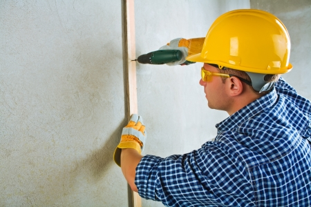 screwdriwer: a contractor working with electrical screwdriwer Stock Photo