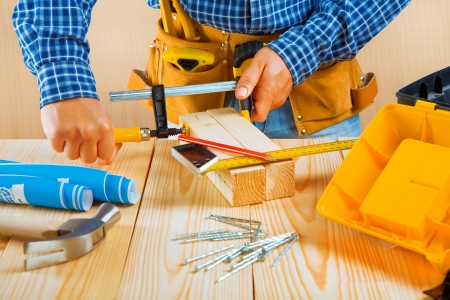 worker fixes two wooden planks Stock Photo - 17204718