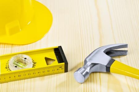 carpentry tools: hammer hardhat construction level