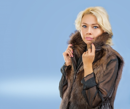 a young blonde in fur coat photo