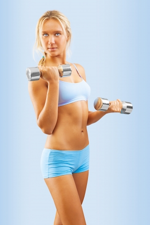 a young blonde with dumbbells photo