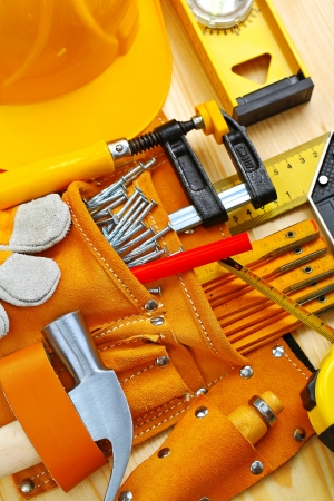 building tools in belt and hardhat photo