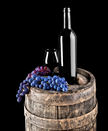 wine bottle and glass with grape on barrel Stock Photo - 18234176